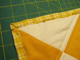cheater quilt bind-off tutorial by rae of made-by-rae guest ... & Rae pretends she can quilt (and shares a quick quilting tutorial) --  cheater binding using the backing fabric Adamdwight.com