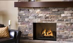 installing stacked stone around fireplace