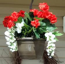 artificial hanging baskets with lights outside