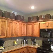 baskets above cupboards organizing your kitchen