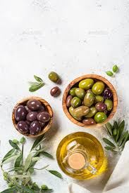 Olive Oak Size Chart Olives In Wooden Bowls And Olive Oil Bottle On White Background