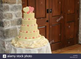 White Chocolate Modern Contemporary Wedding Cake Sits In A Reception