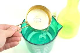 diy kitchen cleaner measuring cup of vinegar poured into water best diy kitchen cabinet cleaner