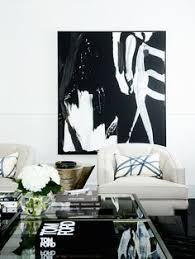 an artwork by kerry armstrong hangs in the family room above a pair of melody club chairs from max sparrow