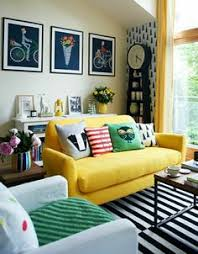 Colorful living room, modern, bookshelf behind couch 8 Furniture-Arranging  Mistakes That Are Sabotaging Your Home (and How to Fix Them)