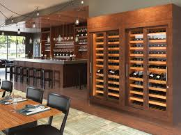 vint standard wine cabinet with a remoted ducted cooling system sliding glass doors and wooden