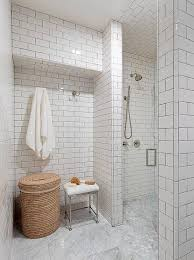 walk in shower with white subway tiles and gray grout