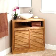 corner bathroom vanity sink cabinet with under small flower vase and mirror near solid wood
