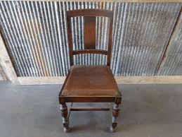 wooden dining chair w brown leather seat sarasota architectural salvage 1093 central ave sarasota fl 34236