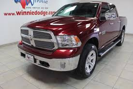 PRE-OWNED 2017 RAM 1500 LONE STAR SILVER 4X4 W/ NAV SYSTEM & BACK UP CAMERA WITH NAVIGATION & 4WD