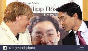 German Chancellor Angela Merkel presents the biography of Vice Stock Photo  - Alamy