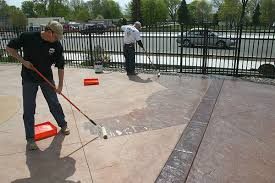 back roll a solvent based acrylic sealer crew members apply and back