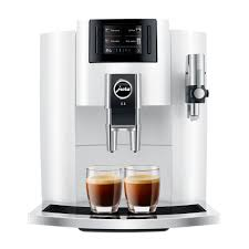 The coffee grounds container catches the used coffee pucks after the brew cycle is complete. Jura E8 Smart Espresso Coffee Machine White 15341 Lifestyle By Focus