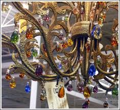 a chandelier with colorful crystal drops
