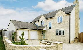 a self build home made from Cotswold stone