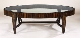 creative design of the oval glass coffe table with black furnished wooden for living room areas