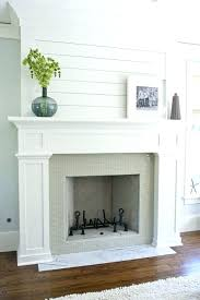 white faux fireplace mantle with storage cabis fake mantel