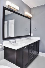 bathroom charming bathroom lighting fixtures over mirror elagant grey wall and dark wood cabinet with