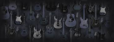 dual monitor wallpaper electric and acoustic guitars