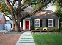 The white trim with the contrasted paint and shutters pop almost as much as  the red