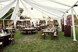 Outdoor Reception Seating Under White Tent With Chandeliers