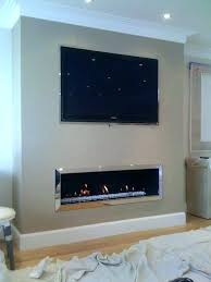 tv mounted over electric fireplace over fireplace pros and cons above gas fireplace ideas home