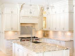 adorable beige color marble countertops features rectangle shape white wooden kitchen island and undermount kitchen sink plus white wooden kitchen cabinets