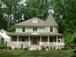 Beautiful Green Queen Anne Victorian House Come with Rounded Shape Stone  Tower and Glass Paneling Sash
