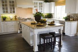A Highly Textured Backsplash Punctuates The White Cabinetry In This Kitchen.  Dark Hardwood Flooring Matches