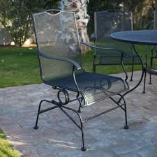 black wrought iron patio furniture with brick motif tiles and round patio table full