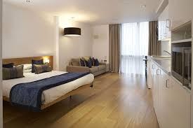 small apartment bedroom designs. Terrific Small Studio Apartment Bedroom Design Feat Blue Blanket Also Wooden Laminate Floor Black Drum Designs E