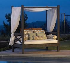 amazing design of the outdoor daybed with canopy with black wooden materials added with white curtain