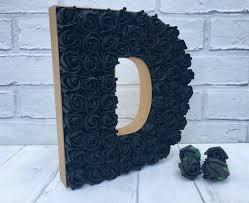 black rose letter d gold and black