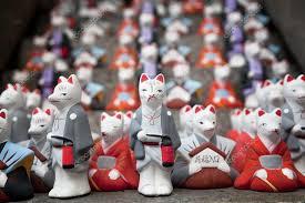statue of the inari fox at fushimi inari shrine one of famous landmarks in