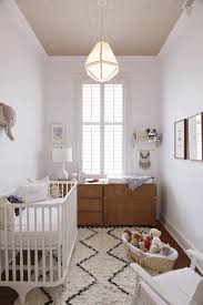 modern neutral nursery with moroccan rug
