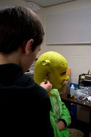 photo of me applying the makeup prosthetics from fxwarehouse for my s ion of shrek the al in 2016 the reason the ears are sticking