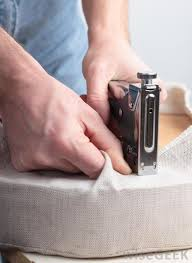 An upholsterer may fasten upholstery fabric by using a staple gun.