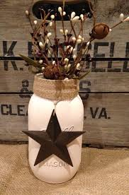 hand painted cream colored distressed mason jar with pip berries burlap and a brown barn star perfect for ber