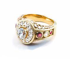 custom diamond and ruby ring in yellow gold created by the atlanta diamond design custom