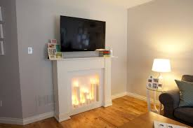 interior cute picture living room and decoration fake gas fireplace entrancing white using all wall paint along with modern long square glass side table