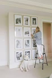 gorgeous gallery wall inspiration with black and white photos gold picture frames