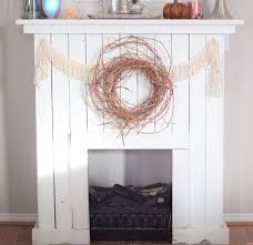 white painted pallet wood fireplace