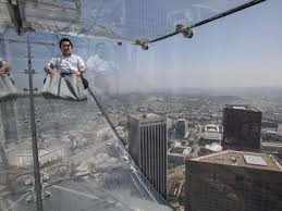 ride the u s bank tower s glass skyslide with 70 floors of nothingness below you