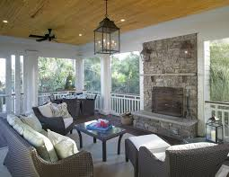 farmhouse porch lights porch traditional with pine ceiling stacked stone fireplace ipe decking