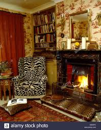 Printed Chairs Living Room Tiger Print Wing Chair And Leopard Print Stool Beside Fireplace In