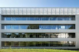 <b>Multifunctional</b> solar protection façade made of <b>stainless steel</b> fabric ...
