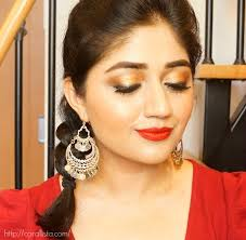 festive makeup for durga puja and navratri gold eyes with red lips
