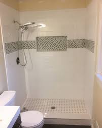Tile shower images Blue Tile Shower Floor And Niche Flooring Masters Gallery Of Custom Showers Flooring Masters Professional Remodelers