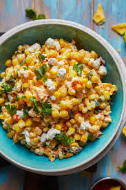 Mexican street corn is seasoned with chili powder and mixed into a creamy cheese sauce to create a great mexican side dish. Healthy Mexican Street Corn Off The Cob How To Video Recipe