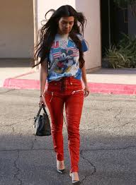 kourtney kardashian wore a pair of stunner red leather bad boys a really cool pair of red leather pants with a lace up fly and zipper front pockets